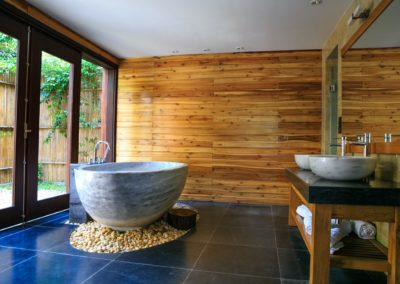 round-white-and-gray-ceramic-bathtub-inside-brown-room-2134224